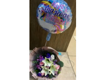 Trendy Lilies with fillers in a bouquet With one random birthday balloon with helium