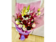 Beautiful mix of half a dozen red roses , pink lilies with other seasonal fillers
