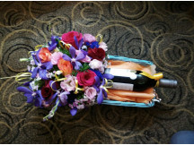 Trendy seasonal floral arrangement with one bottle of red wine