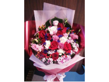 As Pretty as You- Impressive mix of 12 red & white roses filled with seasonal fillers.
