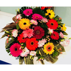 Colorful mix of  Daisies arrangement in a  basket