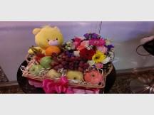 A Bundle of 100% Fresh Flowers, Assorted Fruits and one random Plush