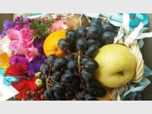 Fresh bundles of assorted fruits and flowers