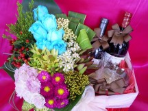 Premier mix of Fresh Exotic Flowers with 2 bottles of Red Wine.